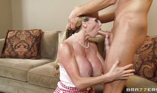 Passionate blonde mature chick Taylor Wane eagerly kneels to take hard packing monster in her mouth