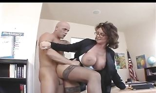 Luxurious mature Deauxma is eagerly sucking fellow