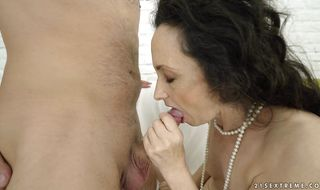 Marvelous mature Milly swallows a big hard pecker
