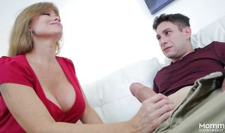Darla Crane with large tits gets out her playmate's pipe and gives him a blowjob