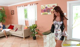 Sassy redhead Esmeralda Payne is having sex with a hunk she likes a lot