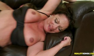 Wicked brunette lady Margo Sullivan is getting banged from the back like never before