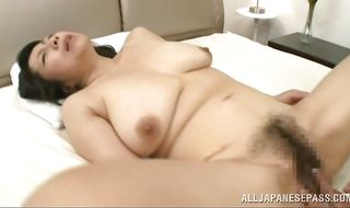 Enticing busty mature gal Rumiko Yanagi is spreading her legs wide and getting her daily dose of steamy fuck