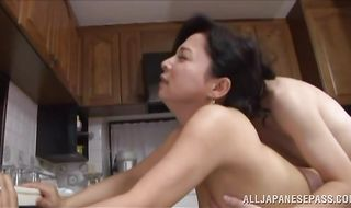 Lewd mature Mai Itou rides a thick python with all of her might