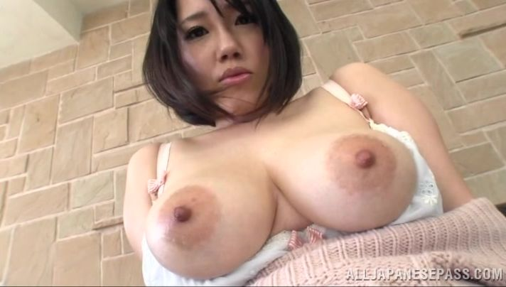Lusty mom Suzuna Komiya with large tits strokes a hard prick