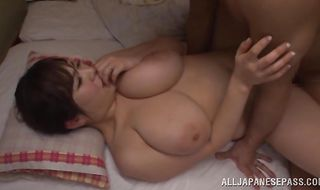 Wanton mature babe Ran Niiyama gets on her knees and sucks a sausage