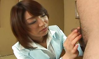 Ambitious Mitsu Anno tames stud's slim jim with a wet hand- and blowjob